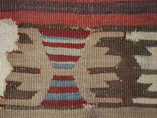 Kilim fragment cod. 0666. Wool. Central Anatolia. Early 19th. century. Cm. 97 x 145 (38 x 57 inches).Mounted on linen.