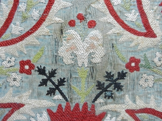 """Ottoman silk embroidered textile's fragment. 17Th. century. Dimension cm. 92 x 56 (36"""" x 22""""). Condition as per images. Sewn onto a black cotton ground and mounted on a wooden stretcher."""