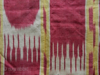 Ikat panel cod. 0772 formed by several stripes sewn together. Silk cotton natural dyes. Uzbekistan. late 19th century. Dimension cm. 84 x 66 (33 x 26 inches). Good condition.