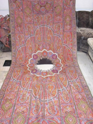 A very beautiful old Kashmir long shawl with a unique center which is not very easy to find,with a few small holes which is very normal in these type of vintage shawls.Colour  ...