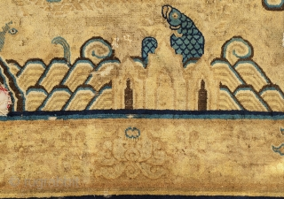 very rare and exceptional fragment of a chinese ming-qing transitional imperial carpet.design and  technic based on ming era palace carpet. the large scale main border with lotos flower design is a  ...