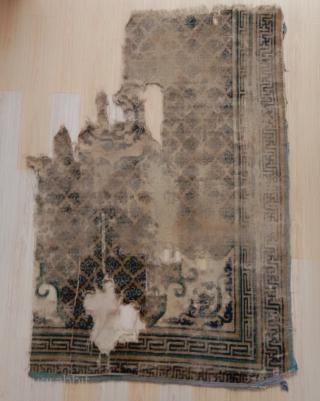 fragment of a rare kangxi era foliated dragon carpet, second half 17th c...