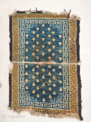 this is the earliest tibetan rug i know with this flamming pearl design (generally called frogs footprint).  incredible well aged green swastika border ,  nothing new about the design elements    ...