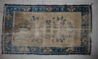 very worn, very early, very rare. very interesting. a 75x 133cm chinese rug, most probably a sleeping rug, and possibly one of those carried originally by the travelling rider. wonderfully drawn large  ...