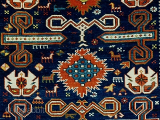 Well balanced Perepedil rug with unusual symbols/motifs. Note the whie palmettes with double headed birds (?) and the 'exploding'flowers throughout the central spine of the rug.  Fully asymmethrically rendered animals and  ...