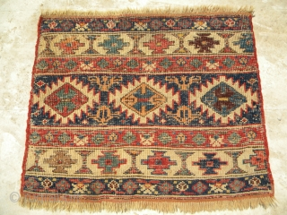 North-west Persian pile mafrash end panel, from a mafrash dated 1303 (circa 1885), 53 x 40 cms, a wide range of natural colours, long pile with few nibbles, soft glossy wool, a  ...
