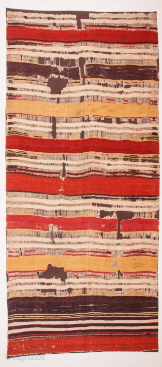 A rare, 18th century kilim. Probably woven in Cappadocia. Minimal and bold with wonderful dyes. Notice the masterful use of three different reds in the middle stripes. Blacks almost completely corroded. Expertly  ...