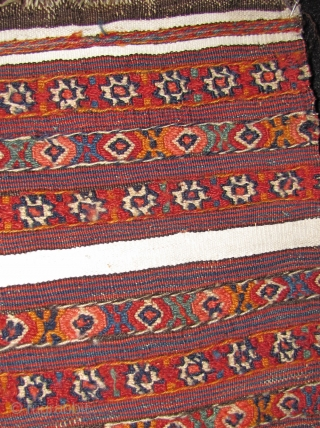 Veramin(?) bagface. 19th century. Reverse sumak and plain-weave. Cotton whites. An unusual piece with really nice dyes. 61x53cms