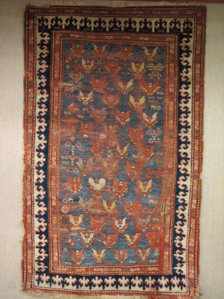 """An old Kazak with an unusual allover design usually associated with the east Caucasus and a beautiful field color. Pleasing to look at even with all its """"issues"""". 122x208cm (4'x6'10"""")"""