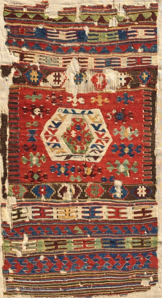 Uncommon, small-format kilim from west Anatolia. Possibly Kutahya area. Displays some features found on Yuncu heybes. The quality of the dyes indicate good age, pre-1850, in my opinion. A happy piece with  ...