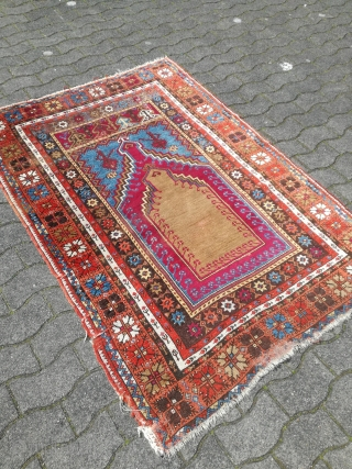 An antique Mucur Kisehir prayer rug with good colors and signs of use. 180/125 cm.