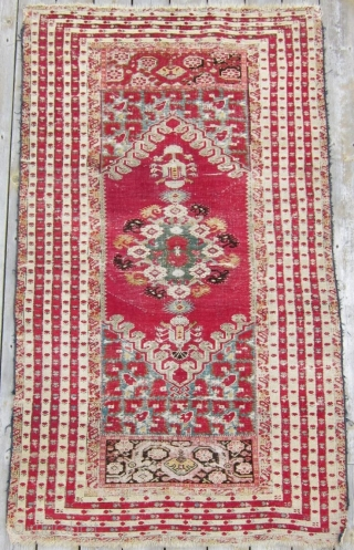 """2nd half 19th c. Turkish Kirshehir rug, 44"""" x 88"""".  Lovely narrow borders surrounding a richly decorated central bouquet of flowers."""
