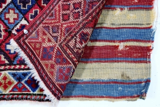 """Shahsavan pile bagface, late 19th c., 21"""" x 23"""".  Shahsavan pile bag featuring a diamond lattice field enclosing multicolored crosses. An interesting border design and lovely natural colors."""