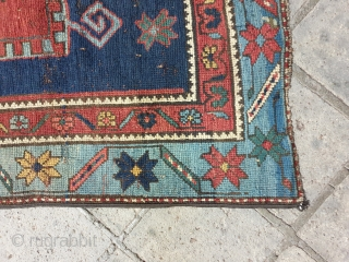 Kazak,knotted rug with symmetrical design,indigo blue on field,in good condition ,wool foundation