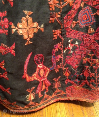 This is a beautiful Palestinian embroidered dress. it has a signature at the bottom and it is in perfect condition. i tried to highlight a photo of the embroidered signature plus a  ...