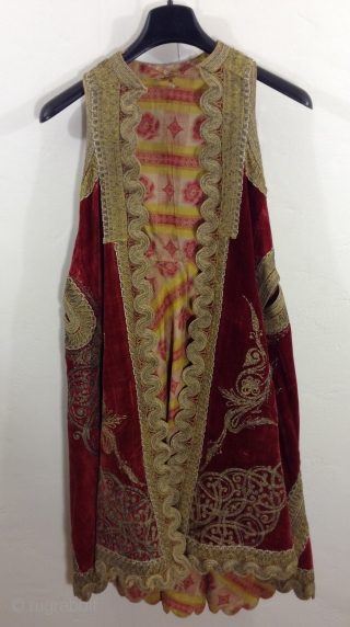 This is a beautiful long sleeveless vest made in either Greece, Turkey or Albania. (The Ottoman Empire) i am not positive although i think It is Turkish. It is made of dark  ...