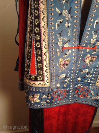 This is a very unusual Chinese suit  mixing a traditional Chinese style pleated and embroidered silk skirt with a more Western style 