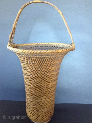 Japanese Bamboo Basket, early  20th century.  Used for Ikebana (flower arrangements).  Comes with bamboo insert. Perfect condition. 18 inches high. Shipping not included in the price.