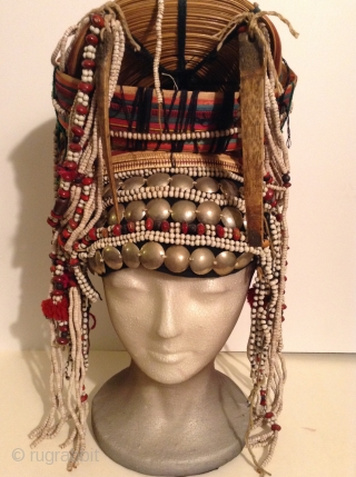 Akha Hilltribe Woman's Hat, either from Thailand or Burma. Woven Bamboo, rattan, seeds, metal beads, glass beads, shells, cotton.  18 inches long and 8 inches wide. Perfect condition.