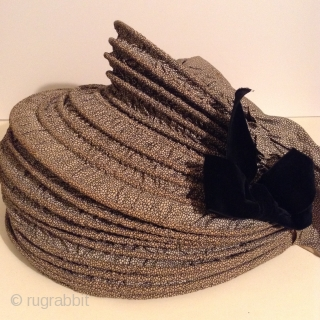 This is a rare Pilgram's Bonnet from the early 19th century.  It has metal stays between the inner and outer fabric that allow the wearer to flatten the bonnet for storage  ...