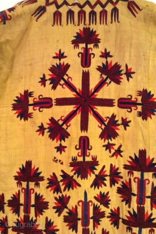 This is a rare Turkmen Chirpy. The yellow color signifies that the lady who wore it was a married woman or simply an older woman.  It is all silk and heavily  ...