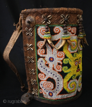Dayak baby carrier.  Glass beads, bark, leather and wood.  high 36 Cm. wide 30 Cm. deep 17 Cm.