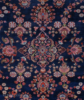 """#7050 Mahajaran Sarouk Antique Persian Rug This circa 1910 Mahajaran Sarouk antique Persian Oriental Rug measures 9'1″ X 11'10"""". It has the so-called empty design motif with a floral medallion.  It  ..."""