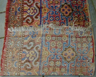 Two fragments from an 18th. century Khotan main carpet:  one fragment in good condition with high pile; another distressed.  Each fragment measuring approximately 61'' X 32''.  Beautiful luminescent wool  ...