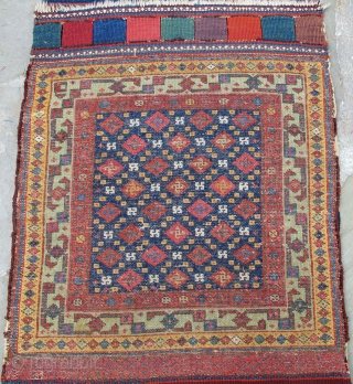 """Mint condition pair of N.W. Persian pile bags, wonderful natural dyes, including aubergine, yellow, and a corrosive green, 19th. century, dimensions of the front of the bag:  24"""" X 22""""[61 X 56cm]"""