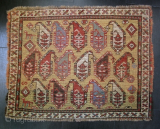 Yellow ground Karabagh mat, edges missing all around, all four sides invisibly stabilized.  Some well-done repiling,  approx. 26 x 33 inches.  SOLD