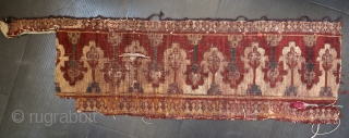 Ruinous reciprocal design border fragment.  The good frags of this rug have gone to some good collections.  Approx 1' x 3'.