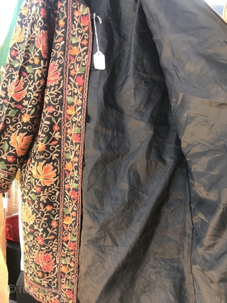 """Kashmir Hand Embroidered Coat  Floral vine and flower """"ari-work"""" hand embroidery with large chinar leaf and small flower pattern on heavier black raw silk. Front opening with silk covered buttons. Lined with black  ..."""