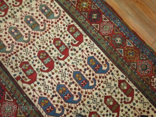Antique Vivid Ivory Kazak 4'x8'10''.  BOught as is..  Cannot see any repairs.  If done they were impeccable.