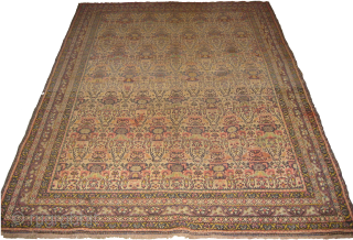 Very old Persian carpet in low pile, size: 7 by 5 ft approximately.