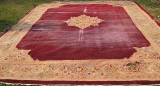 An extremely fine Indian rug measuring 18 feet by 12 feet approximately, needs repair.