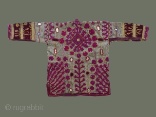 From eastern Afghanistan, possibly Nuristan, or Paktia  Province, near the border with Pakistan, this ornate man's coat is a superb example of its genre. Made of a heavy, thickly woven fabric  ...