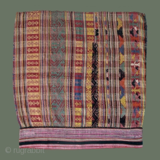 Rare Lao tubeskirt with unusual colors and weave- probably made by a Khmu weaver (non-Tai) to be worn in Xam Neua and identify with the local Tai. Note typically-Tai figures in detail.  ...