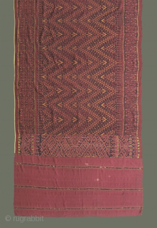 Antique Khmer 'Chawng kbun' - This textile was probably made for ordination ceremonies where the young ordinands are called 'naaks', another word for 'naga'. In multiple shades of red, plus yellow accents  ...