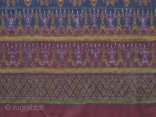 Antique Khmer Silk - Complexly patterned, harmoniously colored and with three intricate borders, this lovely textile is a visual delight. It was used as a man's lower body garment for ceremonies. Each  ...