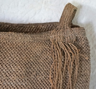 Chinese Ethnic Minority rope knotted utilitarian bag... Made from Hand rolled jute or hemp, this Chinese rope bag was made and commonly used by the Yi ethic minority.  There is a change  ...