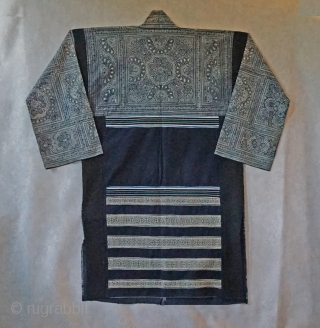 Vintage Chinese Miao Ethnic Minority long jacket...   intricate batik using indigo dye...all hand sewn... hand woven ribbon strips decorate the lower back...  easy to wear, field tested by me... looks great hanging on  ...