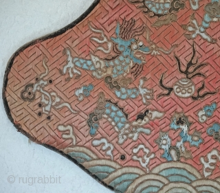 Tradition Lotus shaped Chinese silk pillow.... Fret pattern Embroidered background with dragons and other creatures using both satin stitch and couching with gold metallic covered thread.... Some fading and some wear around the  ...