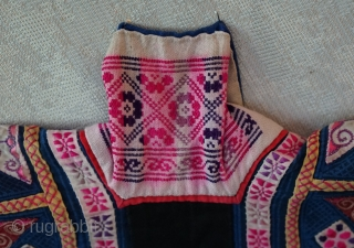 "Made by a women of the Miao minority often referred to as the ""tiny Miao"" ...not because of their stature but because they were recognized for their ""tiny"" embroidery stitches... This jacket  ..."