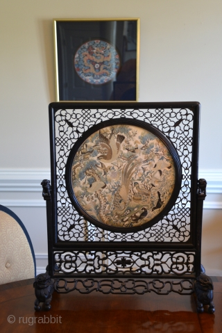 1850 Chinese table screen silk embroidery panel mounted in carved hardwood frame. The panel is densely embroidered with various birds, including an eagle and two peacocks in the foreground, with pine trees,  ...
