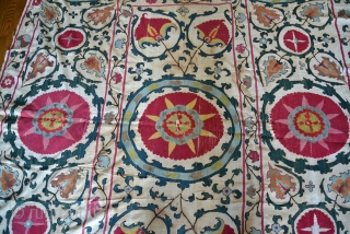 19th Century Uzbek Bukhara Suzani made of 8 almost equal panels stitched together vertically. Very good condition with very minor fraying and light stains. All natural colors include apricot, magenta, red, several  ...