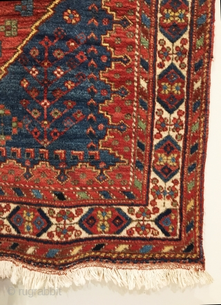 "Antique Afshar Rug. Circa 1900. The design exhibits dual 'ashik tipped' medallions on a saturated madder red field. Mint condition. 9 colors. 4'10"" x 6'4"". Delicately hand washed."