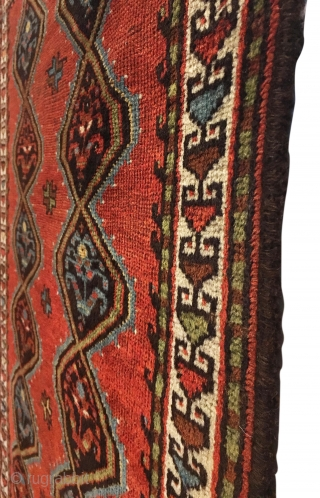Antique Persian Veramin Rug. Late 19th Century. This piece features a repeating diamond pattern enclosing alternating shrub flowers on a saturated cherry red field. Featuring a central row of multi-colored secondary motifs.  ...