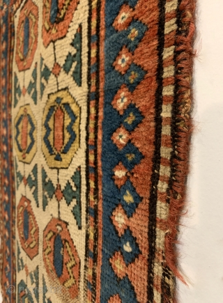 Antique Rare Gendje Small Rug. Circa Early. Two rows of elongated Gendje border ornaments on white ground field framed by blue trefoil border. Saturated dyes including a nice green. Original condition. Old  ...