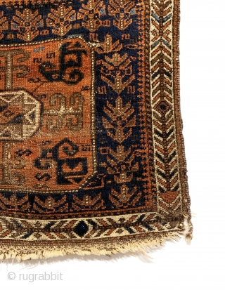 Antique Baluch Bagface. Northeast Persia. 2nd Half 19th Century. Shrubs and S design on blue field surround Tukoman like Gol with quartered dragon elements. Interesting white ground border. Original condition. Nice wall  ...
