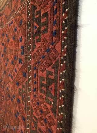 Chakhansur Baluch Rug.  Circa Antique.  Four sides original, no repairs.  4 colors.  63 x 37.  Clean and hand washed.